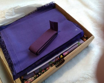 Box of fabric - purple