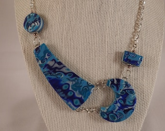 Asymmetry in Blue necklace and earring set polymer clay