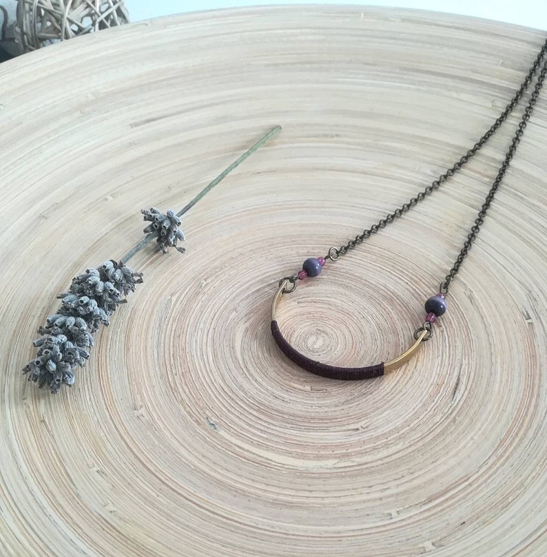 Long boho style necklace with dark bronze chain and gold half moon pendant decorated with grape silk thread round beads and glass beads