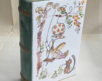 Vintage ceramic bank book piggy bank girl swinging cat Italy