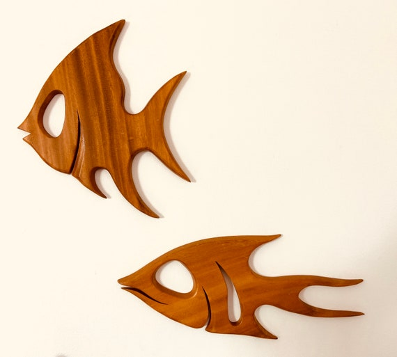 Pair of Mid Century Carved Monkey Pod Fish by Woodpecker Woodware