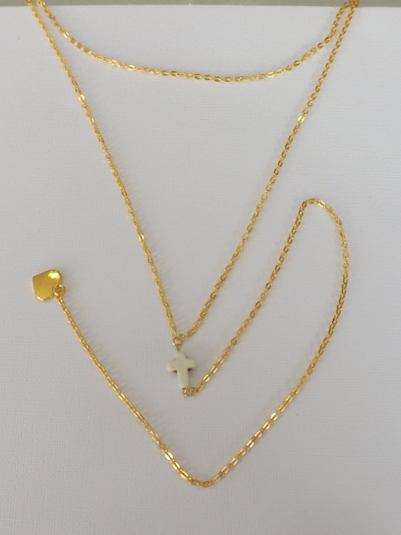 Ladies gold plated 2 strand Y style necklace with carved stone cross and gold plated heart