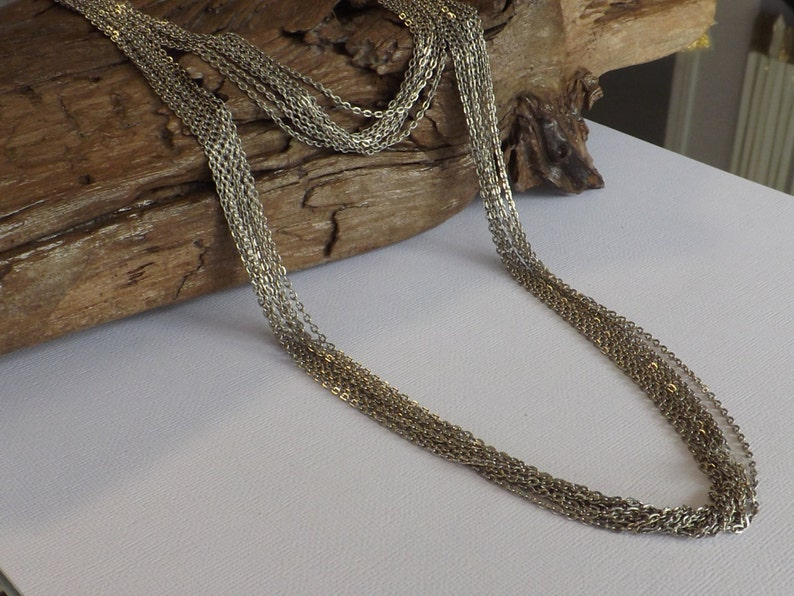 Multi strand chain necklace made with 2 lengths