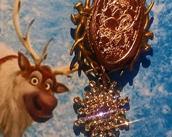 Frozens Kristoff And Reindeer Sven Brooch Pin Featuring Bronze Antlers A Disney World Pressed Penny Dangle Rhinestone Snowflake Charm