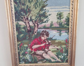 Antique needlepoint picture...boy in the meadow....gold, wooden frame.....vibrant colors...large