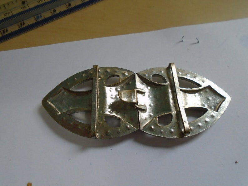 1 art deco buckle with  white pastes set in chrome Back to back half tear drop shape 1920s  3 14 X 1 38 ref 9021