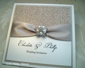 Champagne Glitter.  Luxury Wedding Invitation with Pearl & Diamanté Brooch.