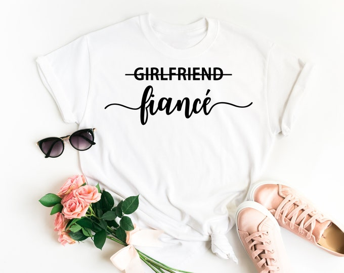 Featured listing image: Fiance Shirt • Girlfriend Fiance T Shirt • Engagement Shirt • Engagement Announcement •Engagement Gift •Future Mrs Shirt •Wife Shirt •TShirt