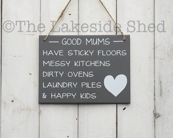 """Grey Hanging MDF plaque/sign """"Good mums have sticky floors, messy kitchens, dirty ovens, laundry piles & happy kids"""""""