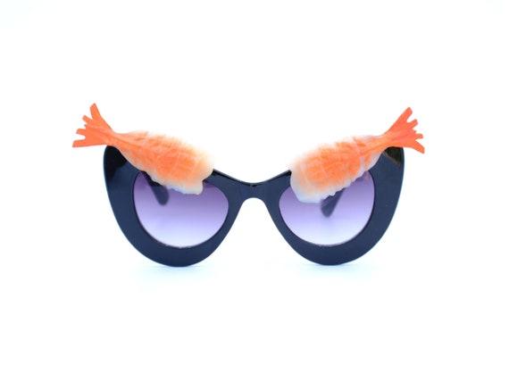 f9506843cac Pink Shrimp Cocktail Eyebrow on Black Sunglasses | Banana Boat,