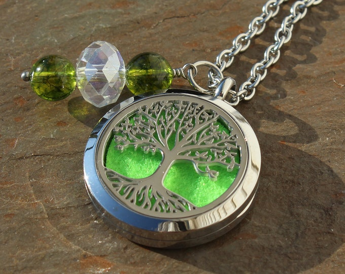 Featured listing image: Tree of Life Locket Stainless Steel Aromatherapy Locket with Peridot Healing Crystals Chartreuse Jewelry Essential Oil Lovers Gift
