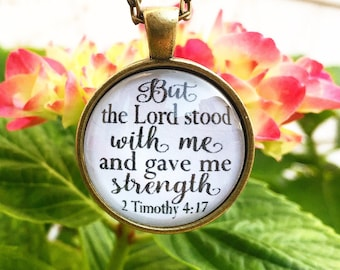 """Bible Verse Pendant Necklace """"But the Lord stood with me and gave me strength 2 Timothy 4:17"""""""
