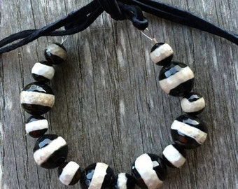 Black and White natural glass beaded bracelet with Suede tie.