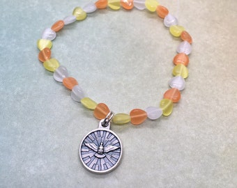 stretch bracelet with small holy spirit medal and tiny cats eye heart beads orange yellow white set the world on fire catholic