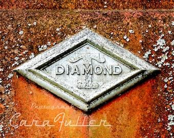 Photograph of the Diamond T Emblem