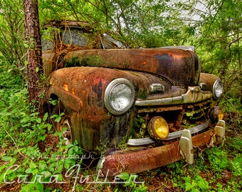 Photograph of a 1946 / Early 1947 Rusty Ford Car in the Woods