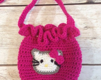 Crocheted drawstring purse with Hello Kitty appliqué