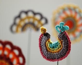 Crochet Bird: a fun crocheted decorative bird on a wire stick.