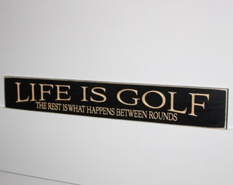 Life is Golf  The rest is what happens between rounds  -   Sign