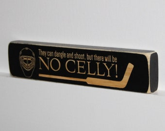 They can dangle and shoot, but there will be NO CELLY!  -  Sign