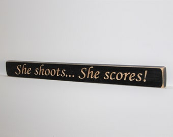 She shoots... She Scores!  -  Sign