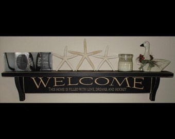 WELCOME This home is filled with love, dreams and hockey  -  Shelf