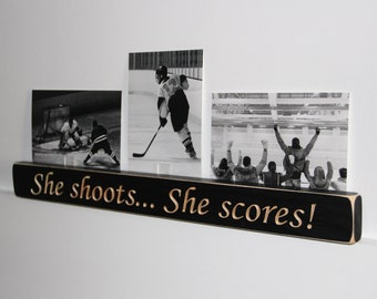She shoots... She scores!  -  Photo Sign