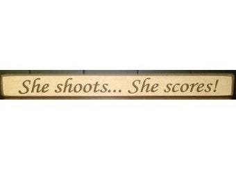 She shoots... She scores!  -  Sign