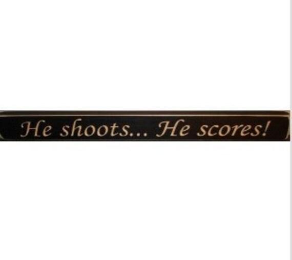 He shoots... He scores! - Sign