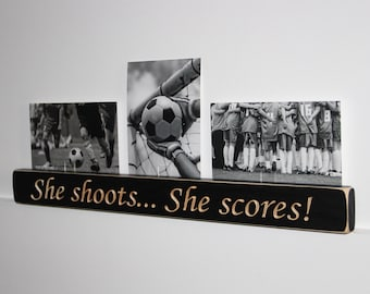 She shoots... She scores!  -  Triple Photo Sign