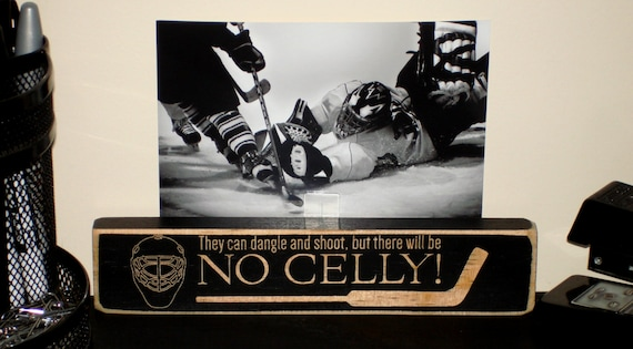 You can dangle and shoot, but there will be no celly!  -  Photo Sign
