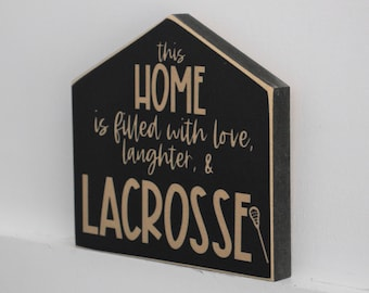 This home is filled with love laughter & LACROSSE  -  Sign