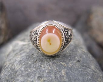 Vintage silver ring with an oval shaped creamy and brown stone
