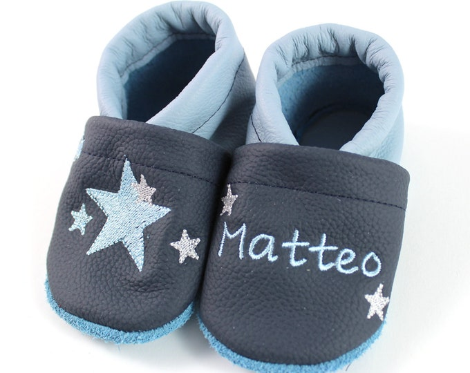 Crawlshoes with names and stars