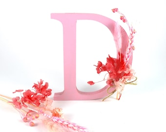Wooden letter with dried flowers