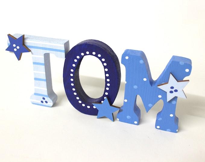 Wooden letters children's room door stars