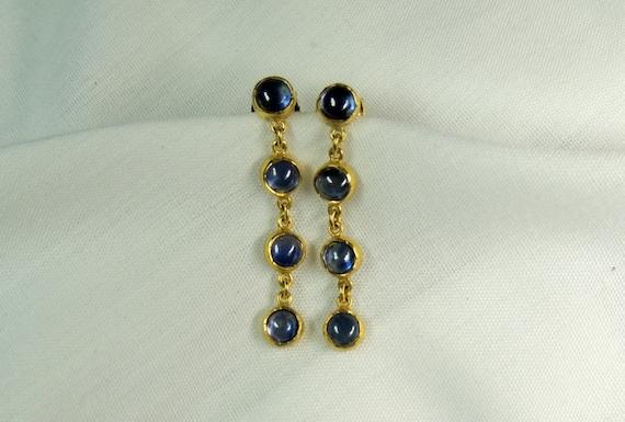 Sexy Dangling Cabochon Blue Sapphire Earring.