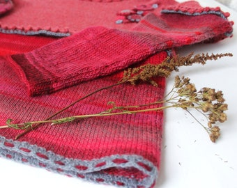 Coral and red wine. Woolen knitted jumper. Pullover coral, red with applique