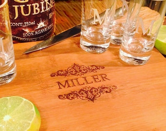 Personalized bamboo cutting board with 2 personalized tequila shot glasses