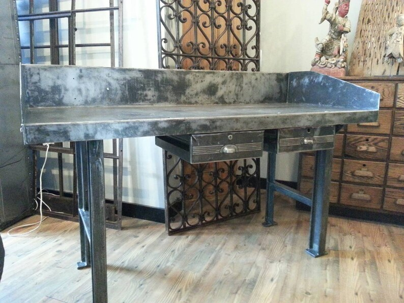 Vintage industrial stripped steel factory table with cast iron image 0