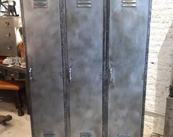 Vintage industrial stripped steel set of three lockers