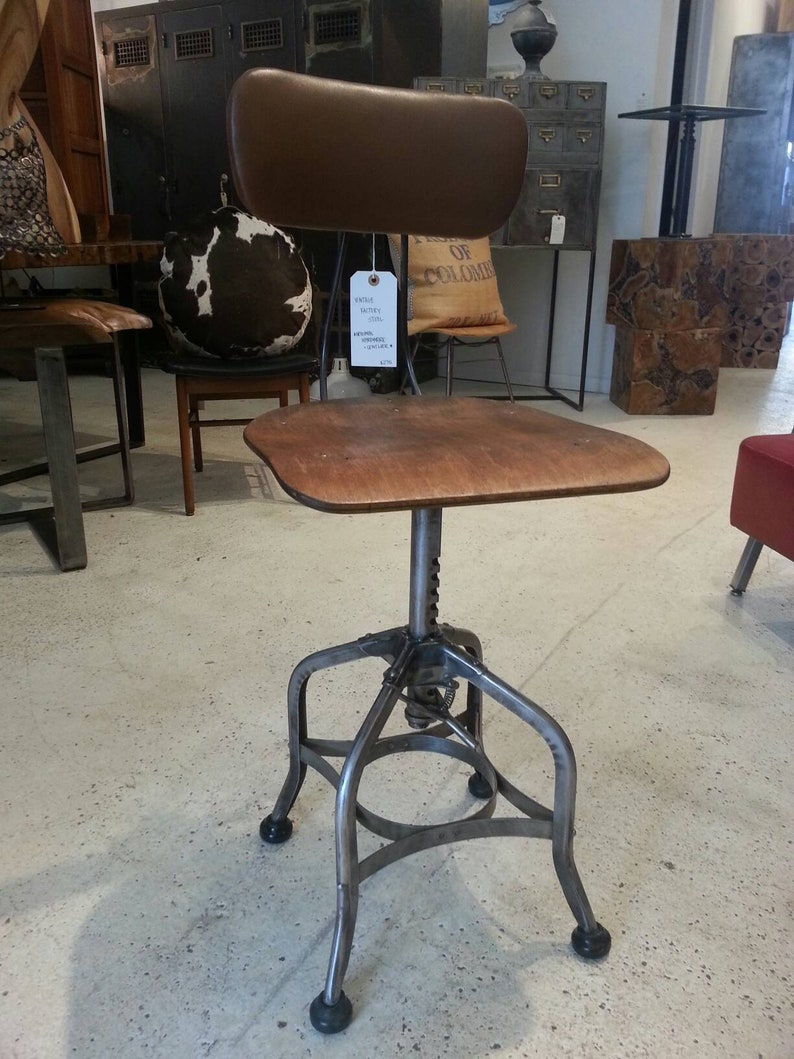 Vintage industrial factory stool with upholstered back rest image 0