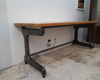 Vintage industrial factory table with maple top and cast iron base.
