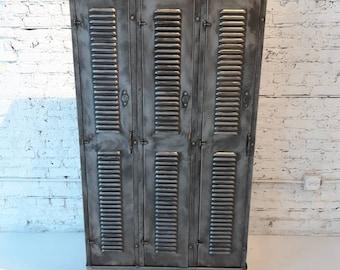 Vintage industrial stripped steel lockers made by the Durand Steel Locker Co.