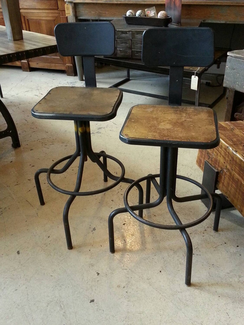 A Pair Of Vintage Industrial Stools image 0