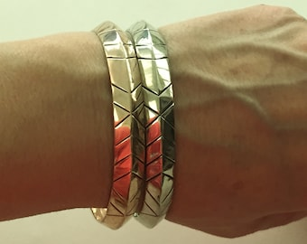 Silver & Rose Gold Stackable Bangles Bracelets.      Rose one Marked HH circle style