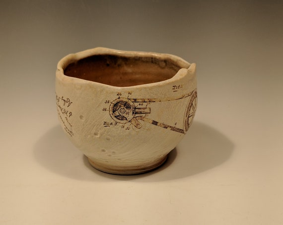 Handmade porcelain woodfire bowl, tea bowl, with gear and butterfly