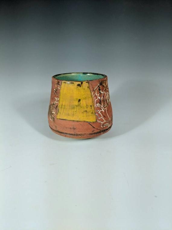 Handmade ceramic wobbly sipper