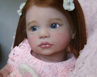 Free Shipping. Reborn Baby Doll Toddler Gabriela by Regina Swialkowski. Rooted Red human hair, Rooted eye lashes, brows. Glass Eyes