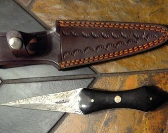 Petite Damascus steel Arkansas toothpick in twisted pattern with heavy duty hand tooled leather sheath